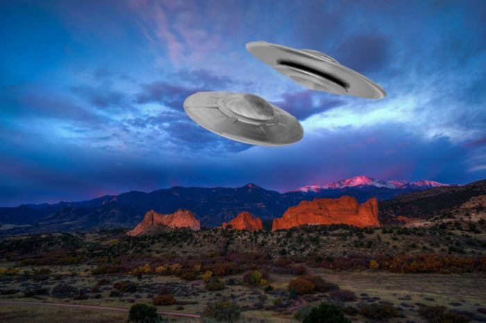 A depiction of UFOs over the mountains