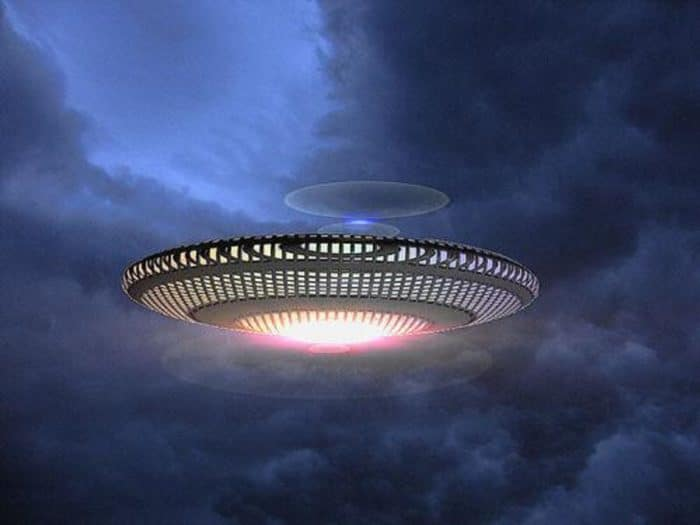 Depiction of a UFO in a cloudy sky