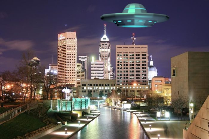 Depiction of a UFO over a city in Indiana at night