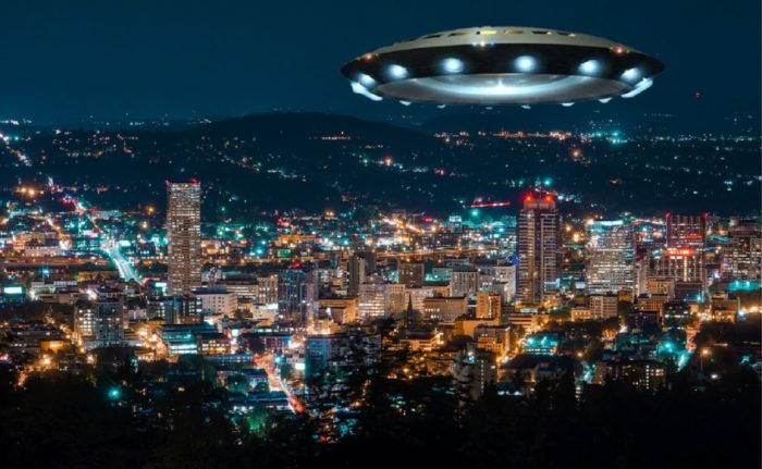 A superimposed UFO over a night scene