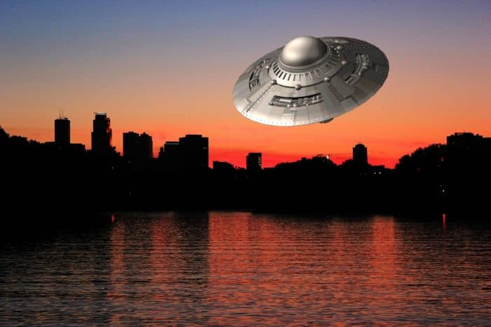 A depiction of a UFO against night skyline