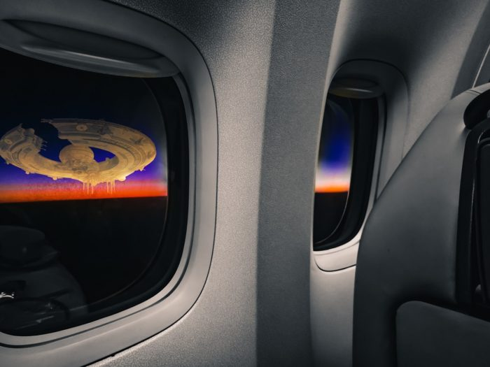A depiction of a UFO outside the plane