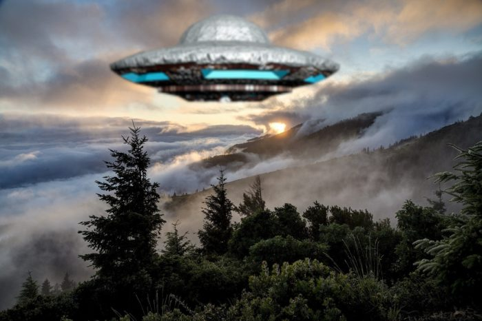 A superimposed UFO on an image of mountains and trees