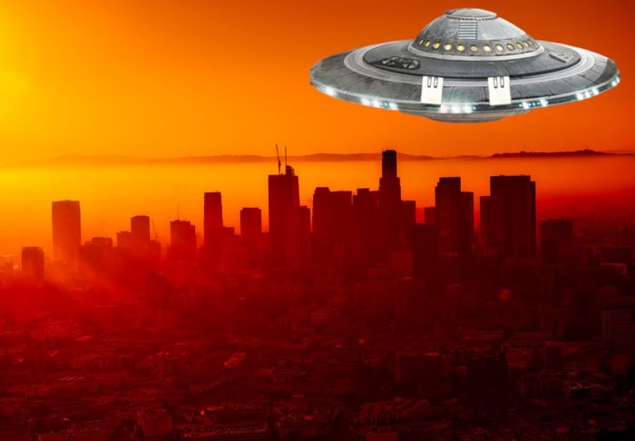A UFO superimposed onto a city in  California at sunset