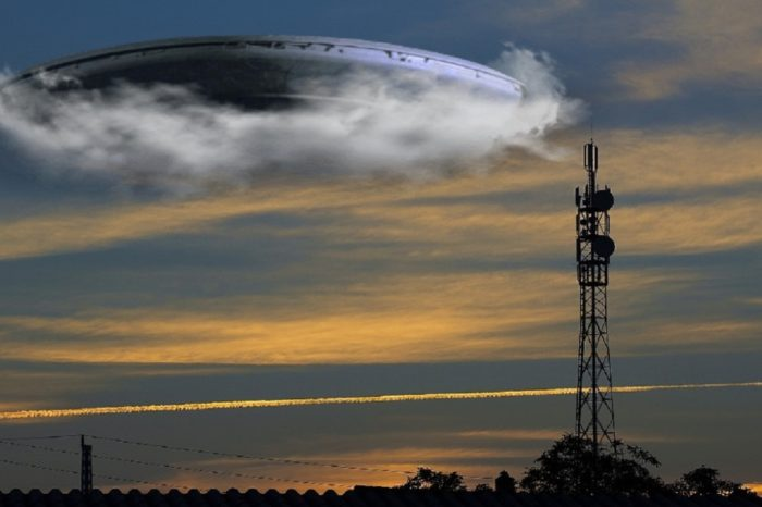 A superimposed UFO over a radio tower