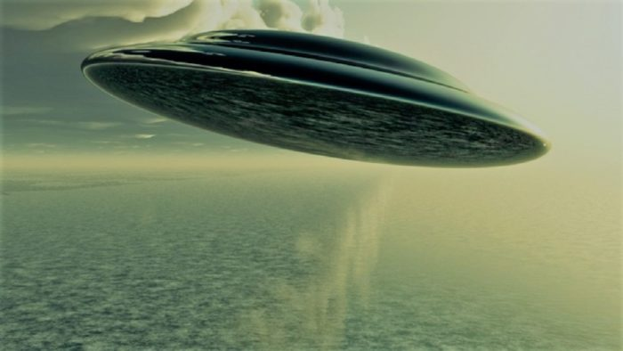 A depiction of a UFO over the water