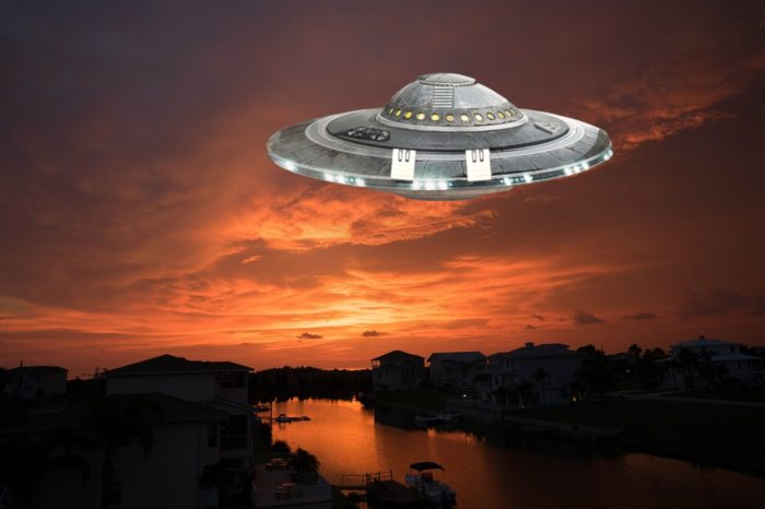 A picture of a Florida lake with a superimposed UFO over the top