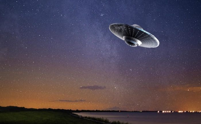 A superimposed UFO over a night sky