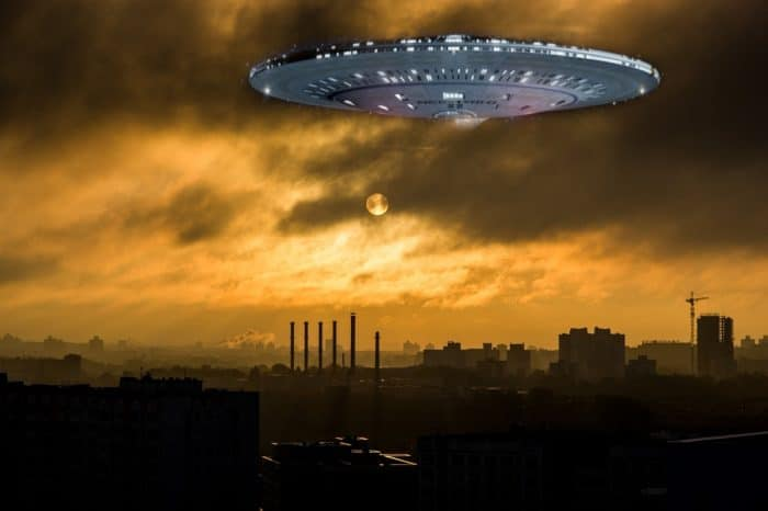 A superimposed UFO in the sunset sky