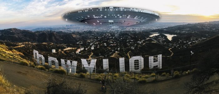 A superimposed UFO over the Hollywood sign