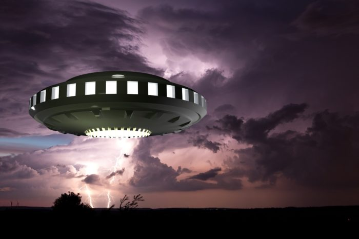 A depiction of a UFO in a stormy sky