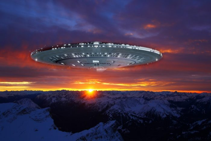 A depiction of a UFO in a sunset sky
