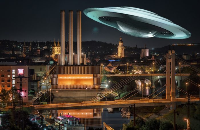 A superimposed UFO over a German city at night