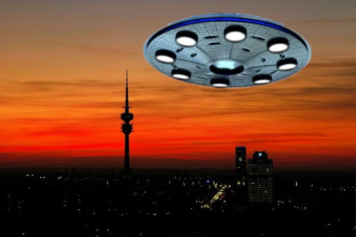 A superimposed UFO over a Germany city at sunset