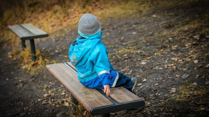 A picture of a child on a bench