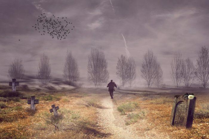 A mystical image of a man running through a graveyard