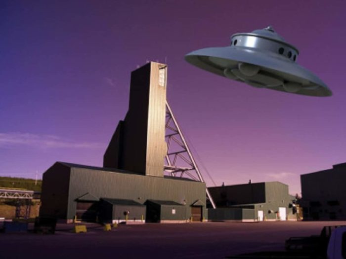 A depiction of a UFO over an Uranium mine