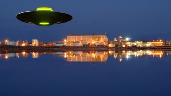 A depiction of a UFO over a lake and river