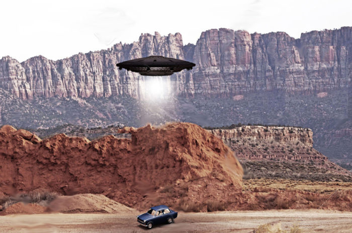 A depiction of a UFO hovering over a car