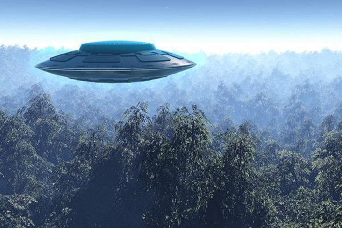 A depiction of a UFO high above a forest