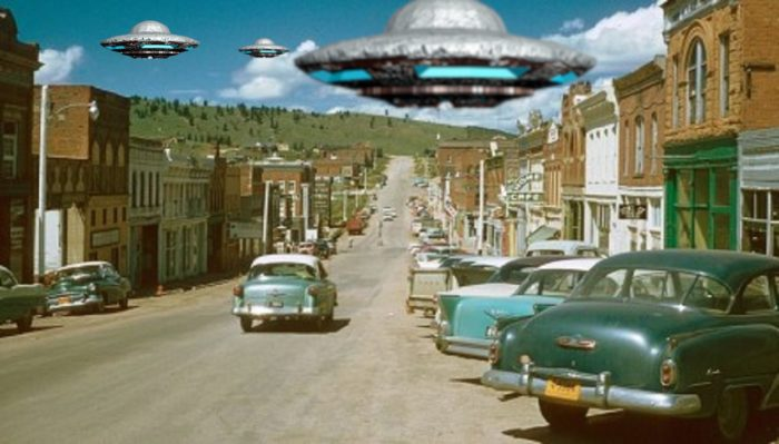 A depiction of UFOs over a typical 1950s scene