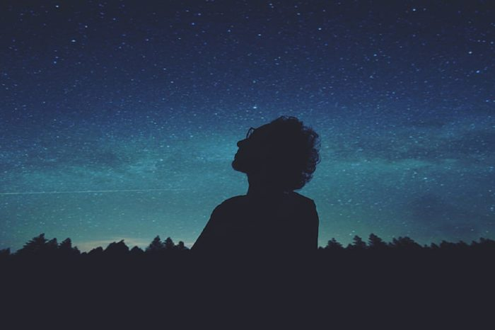 A picture of a woman looking up to the stars