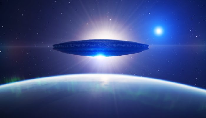 A depiction of a UFO high above the Earth