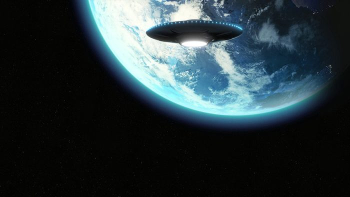 A depiction of a UFO approaching the Earth