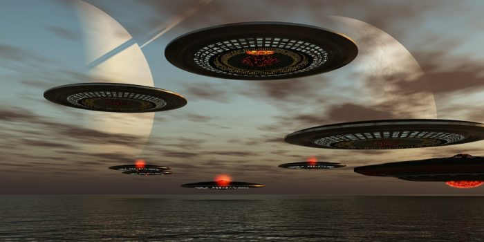 A depiction of a fleet of UFOs over the water