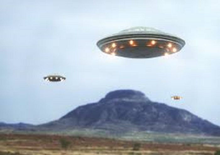 Superimposed UFOs over a mountain