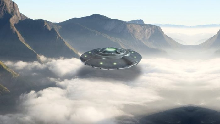 A depiction of a UFO flying over mountainous terrain