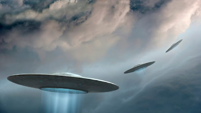 A depiction of three UFOs
