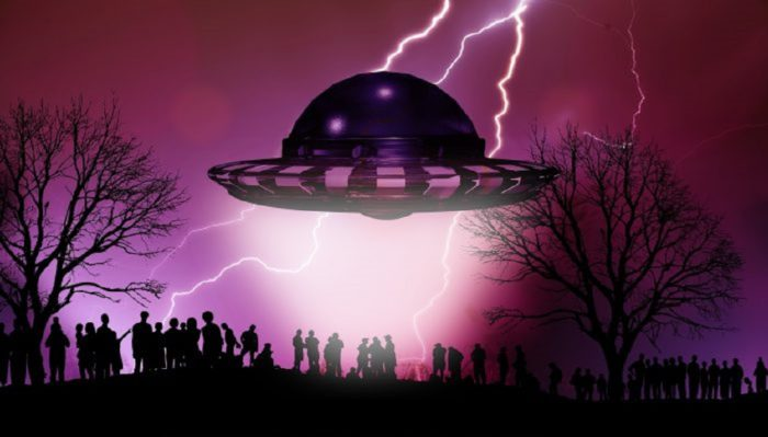 A depiction of a UFO hovering over a crowd of people