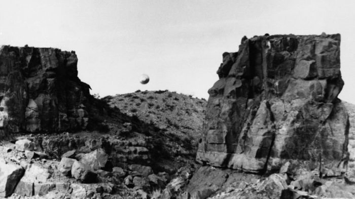 A picture claiming to show a real UFO over the mountains of the US