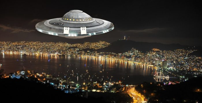 An superimposed UFO over a night scene