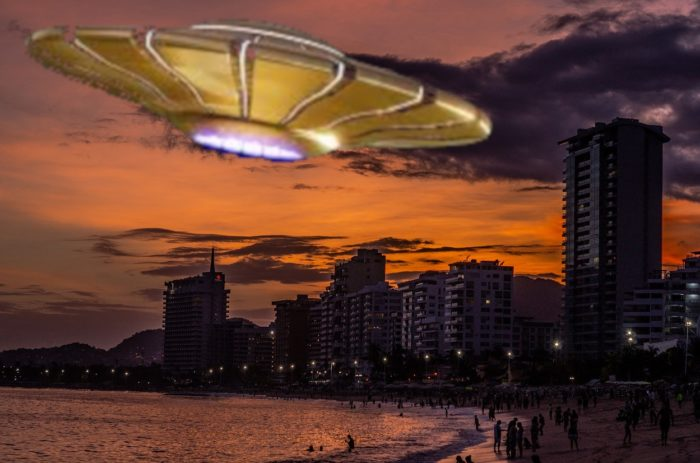 A superimposed UFO over a city shoreline at night