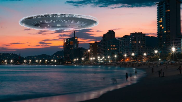 A superimposed UFO over a beach at night