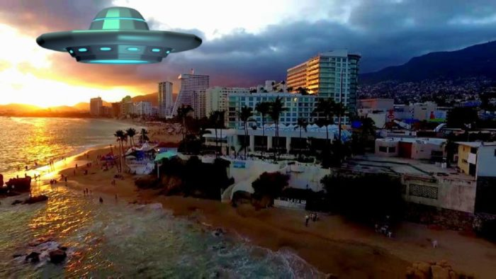 A superimposed UFO over beachside hotels at night
