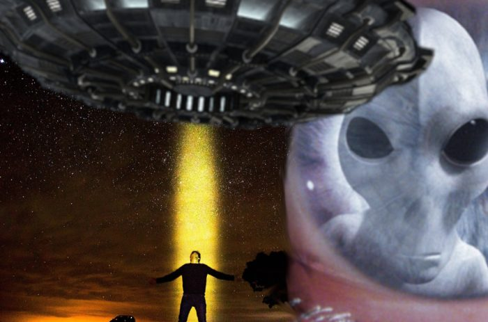 An image of a person being lifted into a UFO blended into an image of an alien face