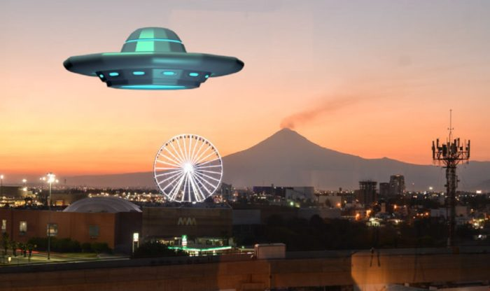 A superimposed UFO over a Mexican fairground at sunset