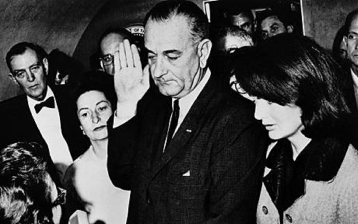 Lyndon Johnson being sworn in as President following Kennedy's assassination