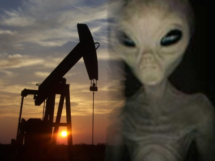A blended picture of an oil drill with a grey alien