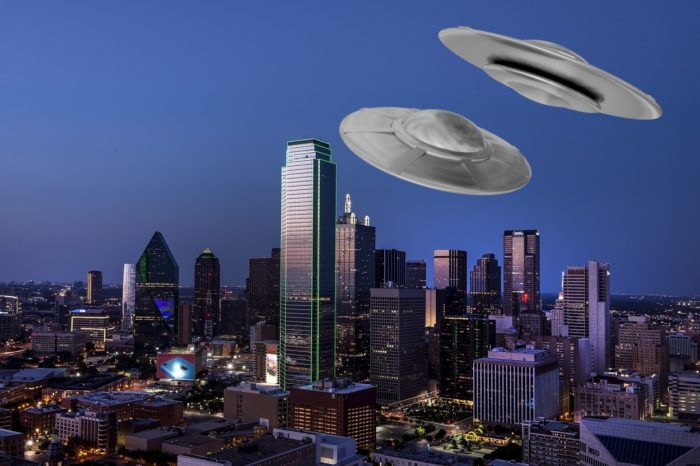 Two UFOs superimposed over a picture of downtown Dallas