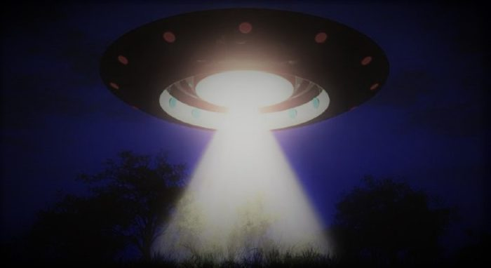 A depiction of a UFO with a light beam coming from underneath