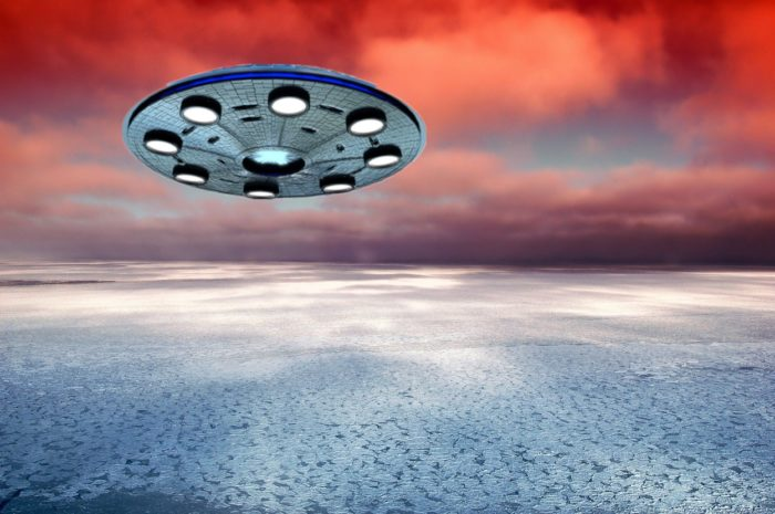 A depiction of a UFO flying through a sunset sky