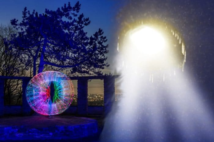 A blended image of two depictions or alien orbs