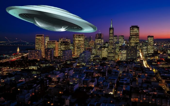 A UFO superimposed onto a night scene of downtown San Francisco
