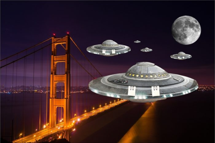 Several UFOs superimposed onto a night picture of the Golden Gate Bridge