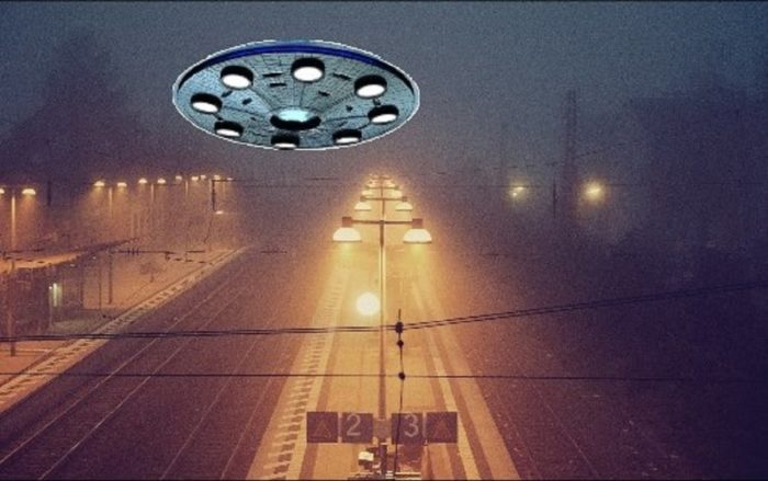 A UFO superimposed onto a picture of a misty train track