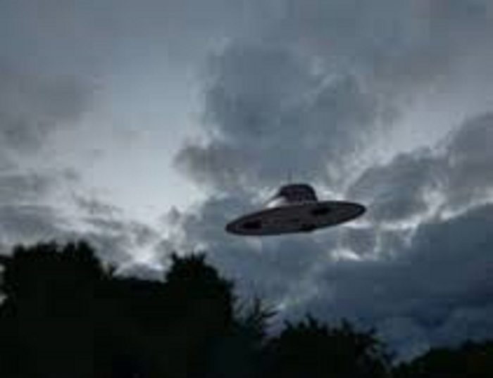 A depiction of a UFO in a dark, cloudy sky